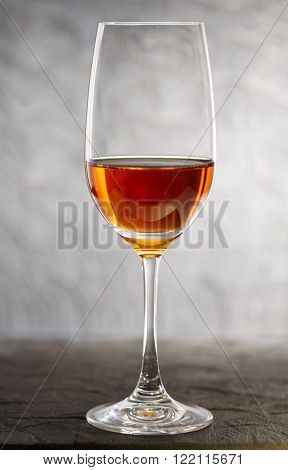 Glass of amontilliado sherry on a wooden plank
