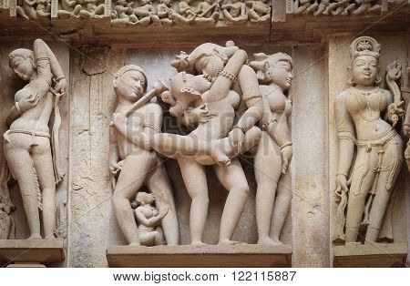 Stone Carved Erotic Bas-relief In Hindu Temple In Khajuraho, India.