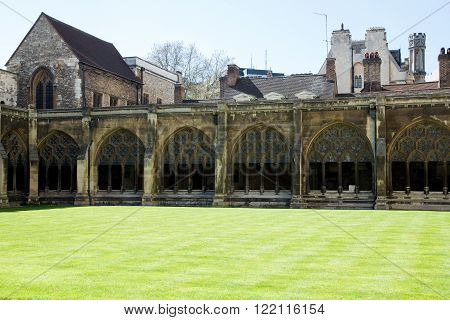 LONDON - APRIL 14, 2015: Courtyard of Westminster Abbey in spring. The abbey is the venue for many royal occasions like weddings and coronations