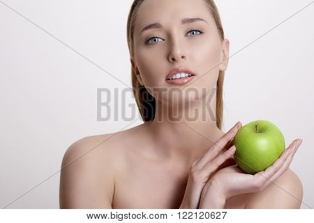 Fresh Young Woman Showing A Green Apple