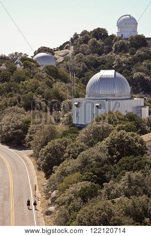 TUCSON, ARIZONA, FEBRUARY 28. Kitt Peak National Observatory on February 28, 2016, near Tucson, Arizona. A couple on a tour walk among the massive telescopes of Kitt Peak National Observatory in Arizona.
