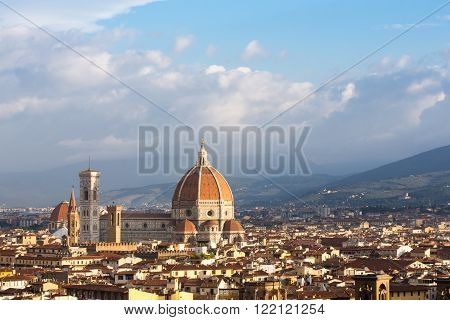 Cathedral of Florence or the Duomo Santa Maria del Fiore in Italy seen in morning light and surrounded by various Florentine buildings. Copy space in sky if needed.