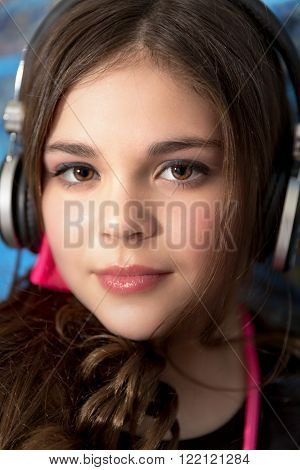 Cute fun and stylish caucasian tween girl wearing head phones