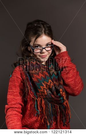 Cute fun and stylish caucasian tween girl wearing glasses