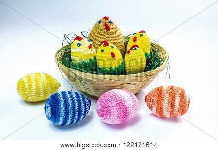 A brood of crochet chickens and some easter eggs.
