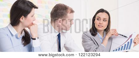Shot of a businesswoman showing a chart to her colleagues