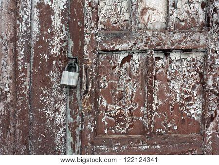 Grungy Wooden Door With Padlock.