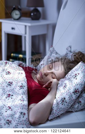 Photo of lonely young woman with mental problem sleeping