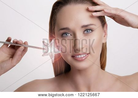 Closeup Of Smiling Woman Holding A Magic Wand