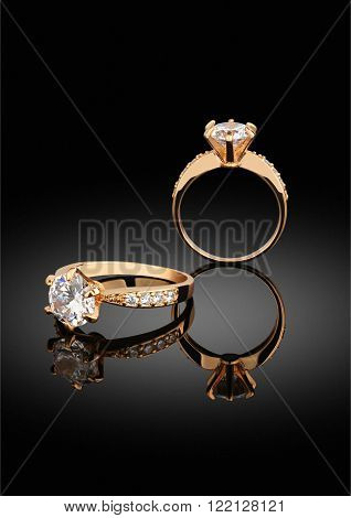 jewelry ring with diamonds on black background with reflection
