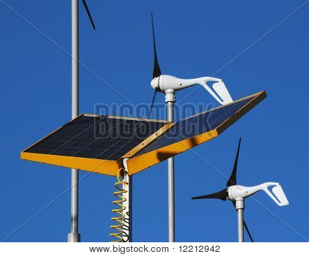 Close-up of wind and solar power generators