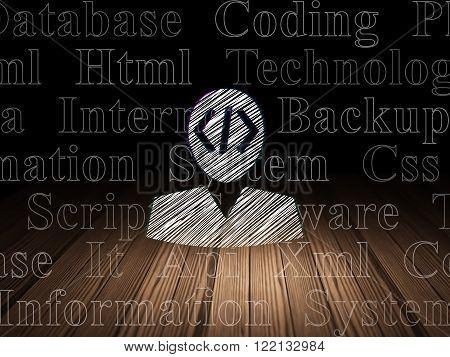 Software concept: Programmer in grunge dark room
