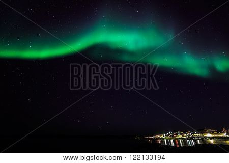 Greenlandic northern lights over the old harbor, Nuuk, Greenland October 2015