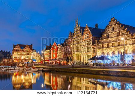Picturesque medieval buildings on the quay Graslei in Leie river at Ghent town at morning, Belgium