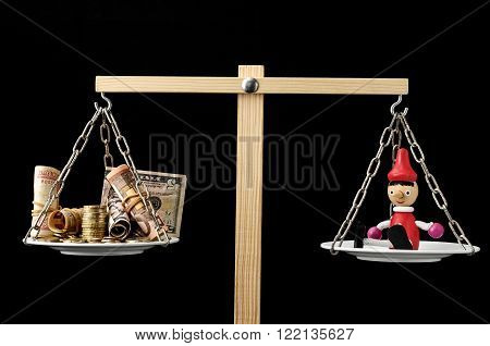 Liar Concept Pinocchio and Money on a Two Pan Balance