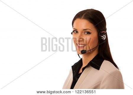 Woman with headset and microphone working in call center for helping customers.
