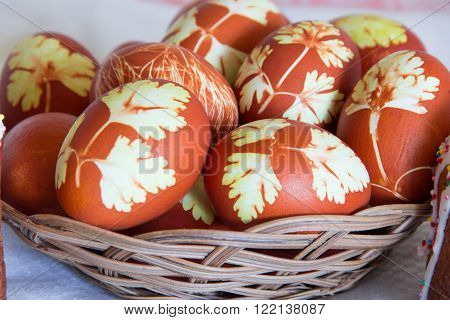 Photo of Easter eggs in wickerwork plate