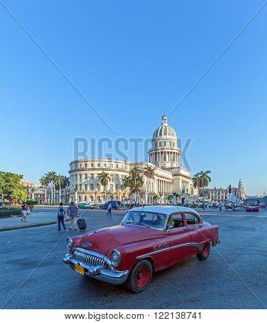Havana, Cuba - April 2, 2012: Black  Car In Front Of Capitolio