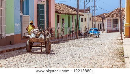 Trinidad, Cuba - March 30, 2012: Horse Carriage And Vintage Car At Streets Of Old City