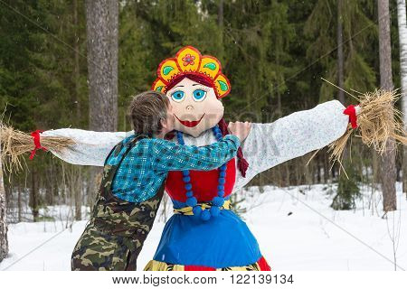 Ivanovo, Ivanovo region, Russia - March 13, 2016: the last kiss the effigy of the carnival at the festival Seeing the Russian winter, 13 March 2016, Ivanovo, Ivanovo region, Russia.