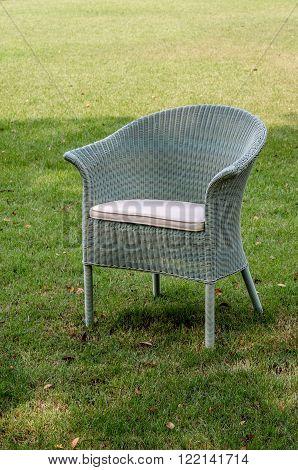 Grey water resistant rattan chair in the garden