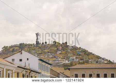 Colonial Buildings And The Panecillo In Quito Ecuador