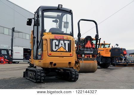 LIETO, FINLAND - MARCH 12, 2016: Cat 301.7D Mini hydraulic excavator and other Cat construction equipment as seen at the public event of Konekaupan Villi Lansi Machinery Sales.