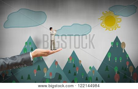Big female palm holding small confident businessman that paly fife