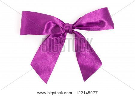 Pink bow close up with white background