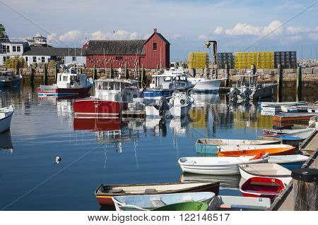 Peaceful early summer evening at Rockport Harbor in Masachusetts. The harbor with its red fishing shack called