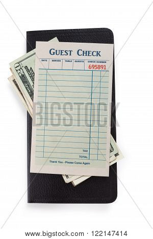Blank Guest Check and dollar concept of restaurant expense.