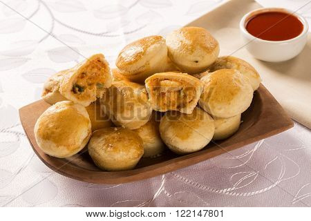 Shrimp patty on wooden background. Traditional Brazilian snack.