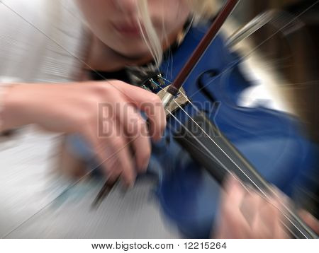 Young musician playing violin in high street