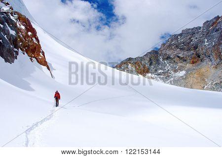 Hiker crosses Cho La pass in Khumbu valley. Sagarmatha National Park Nepal Himalayas