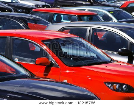 Telephoto view of cars parked in parking lot