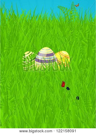 Decorated Easter Eggs Over Spring Green Grass with Butterfly