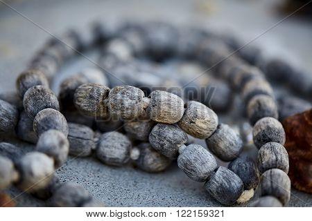 weathered sacred vintage wood prayer beads closeup