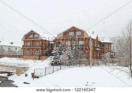 Large wooden manor house on the banks of the river Belokurikha in the resort area of Belokurikha, Altai Krai, Russia.
