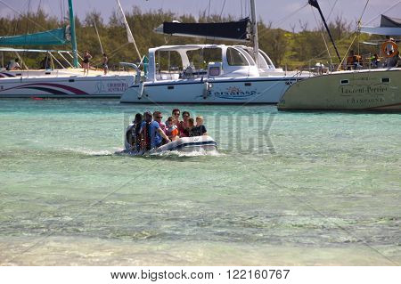 MAURITIUS - APRIL 24:tourists are transported by the small boat from a catamaran on Gabrielle's island on April 24 2012 in Mauritius.