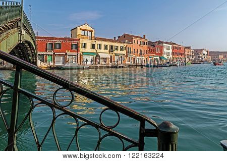MURANO, ITALY - JANUARY 25, 2016: Venice, Italy, Murano water boats canal and traditional buildings.117 islands separated by canals and bridges. Murano is glass making island. World Heritage Site.