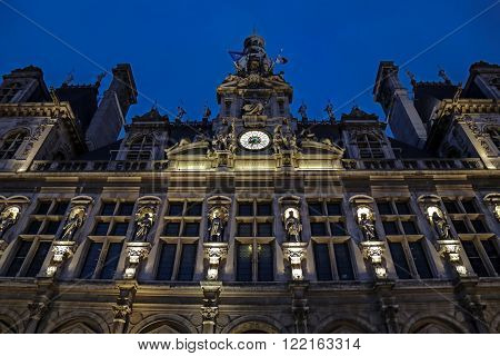PARIS FRANCE - OCTOBER 11 2015: Paris City Hall illuminated at night. l'Hotel-de-Ville against the City Hall. The City of Paris's administration has been located on the same location since 1357.
