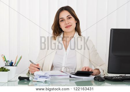Young Happy Businesswoman Working With Taxes At Office
