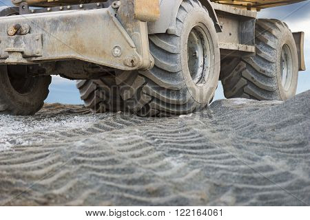 Close up of wheel of excavator on building site