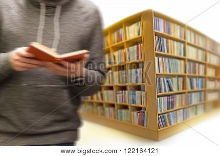 Man with book in blurred motion in library