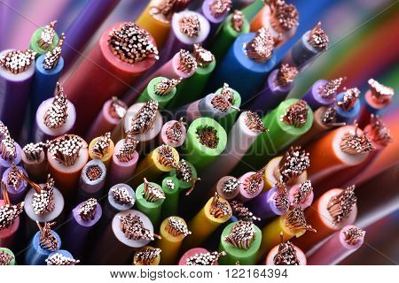 Group of colored electric cables and wires closeup