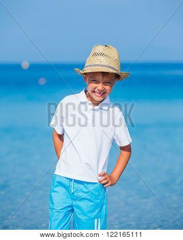 Boy walking the tropical beach