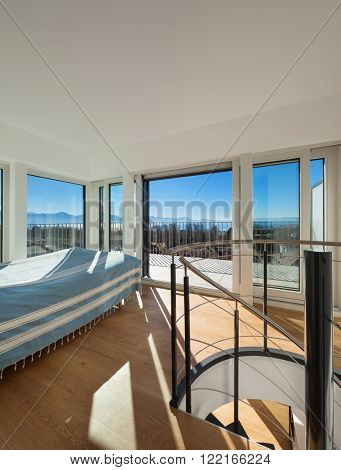 Interior, bright bedroom of a duplex, parquet floor