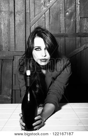 Stylish Woman With Bottle