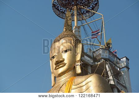 Temple Wat Intharawihan in Bangkok. It was built at beginning of Ayutthaya period, one of the main features is a 32-metre high, 10-metre wide standing Buddha