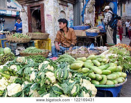KATHMANDU NEPAL - 4 APRIL 2014: The street vendor sels his fruits and vegetables in Thamel in Kathmandu Nepal.